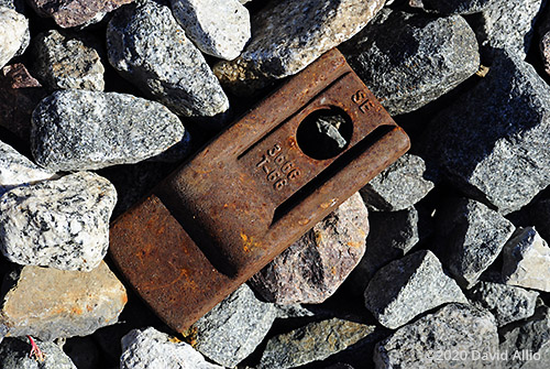 Rusted railroad steel discarded on metamorphic stone in Vermilion County Illinois still life Americana Collection